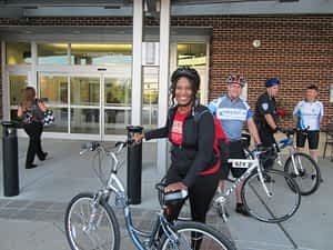 Annette Dickerson arrives at work on Bike to Work Day